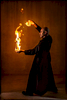 man indoors with his hands on fire. magician with fire