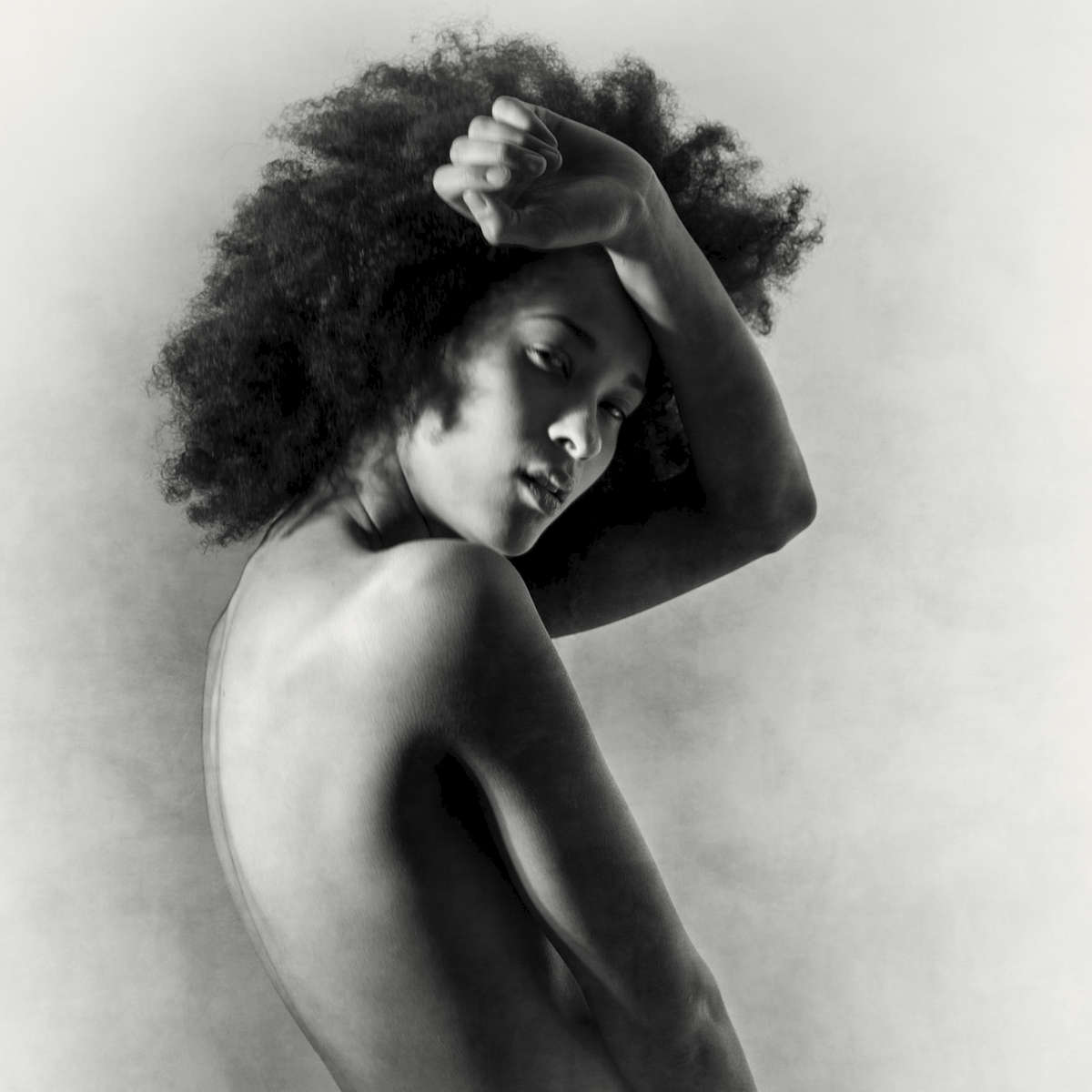 fine art black and white studio female nude with an afro