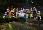 A spiritual caravan gathers before an altar as they make their way upriver carrying prayers, offerings and song.