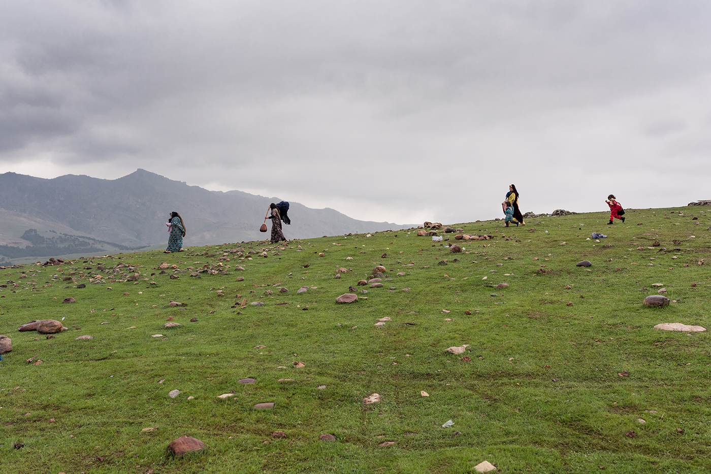 Kurdish women traveling across the Qandil mountains.