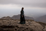 A kurdish woman stands atop the bombed out ruins of Saddam Hussein's summer palace on Gara mountain.  From this vantage point Hussein would plan the al-Anfal genocide which resulted in the slaughter of tens of thousands of Kurds from 1986 to 1989.