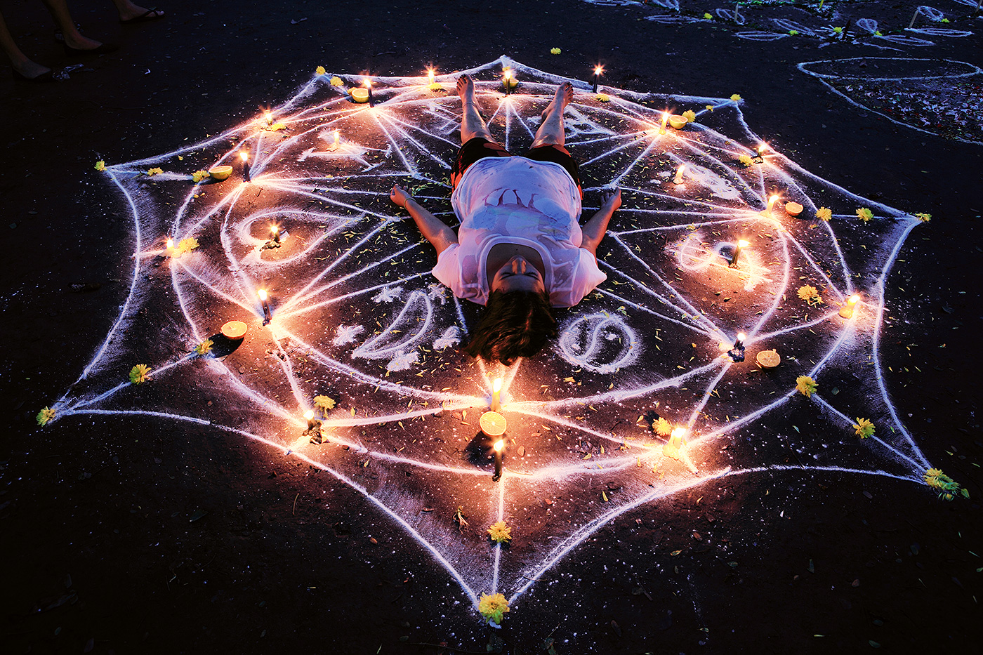 The oracle consists of an elaborate chalk drawing that serves as a focal point between the cosmos and the earth, directing these powerful energies into the participant.  Each oracle contains a symbology reflecting the needs and wishes of those who enter its space.
