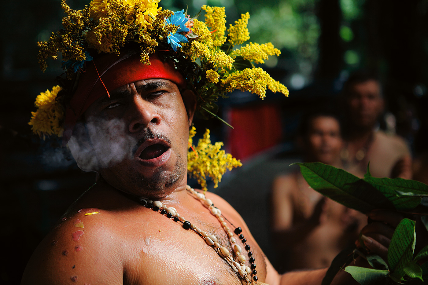 Smoke indicating the presence of the spirit is exhaled by the Banco, a medium between the ethereal world and his caravan.  He is responsible for the revelation of the Mysteries, as well as directing the ceremony.  His authority is absolute over all matters earthly and spiritual.