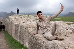 A young member of the Kurdish PDK Peshmerga.  The Barzani family military wing for the Federal region of Iraqi Kurdistan.  Peshmerga translates as {quote}those who face death{quote}.  Their existence predates that of the country of Iraq.