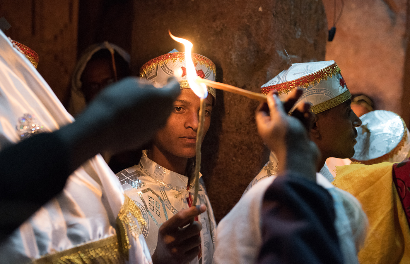 Fasika/Easter morning.  The flame of the church at Bete Maryam is lit by a young deacon who carries it to the gathering priests to begin the Midnight Mass.