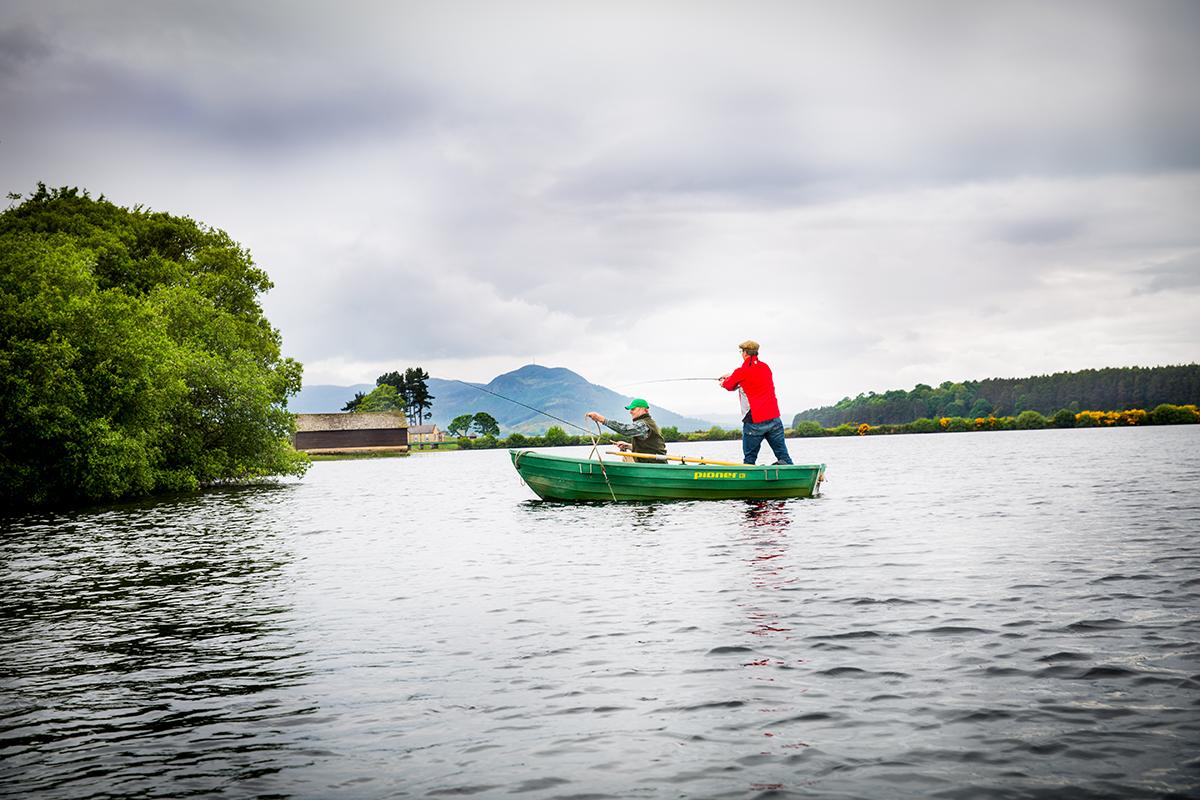 boys-fishing-in-boat