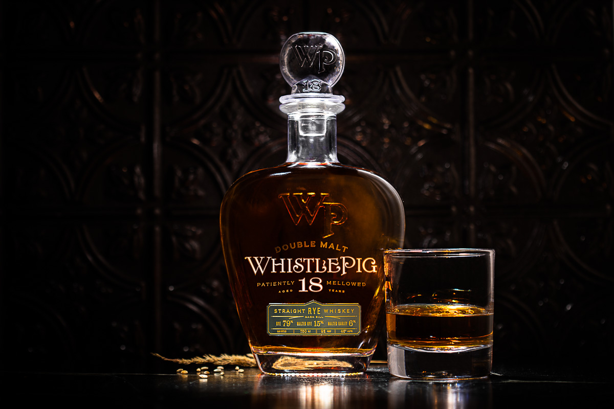 Beverage Photography of Whistlepig's 18-year whiskey with a glass stopper by Simon Pearce.
