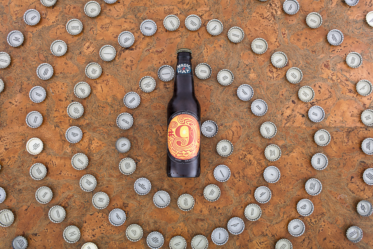 Magic Hat Brewing beer Number Nine with bottle caps in a swirl shape.