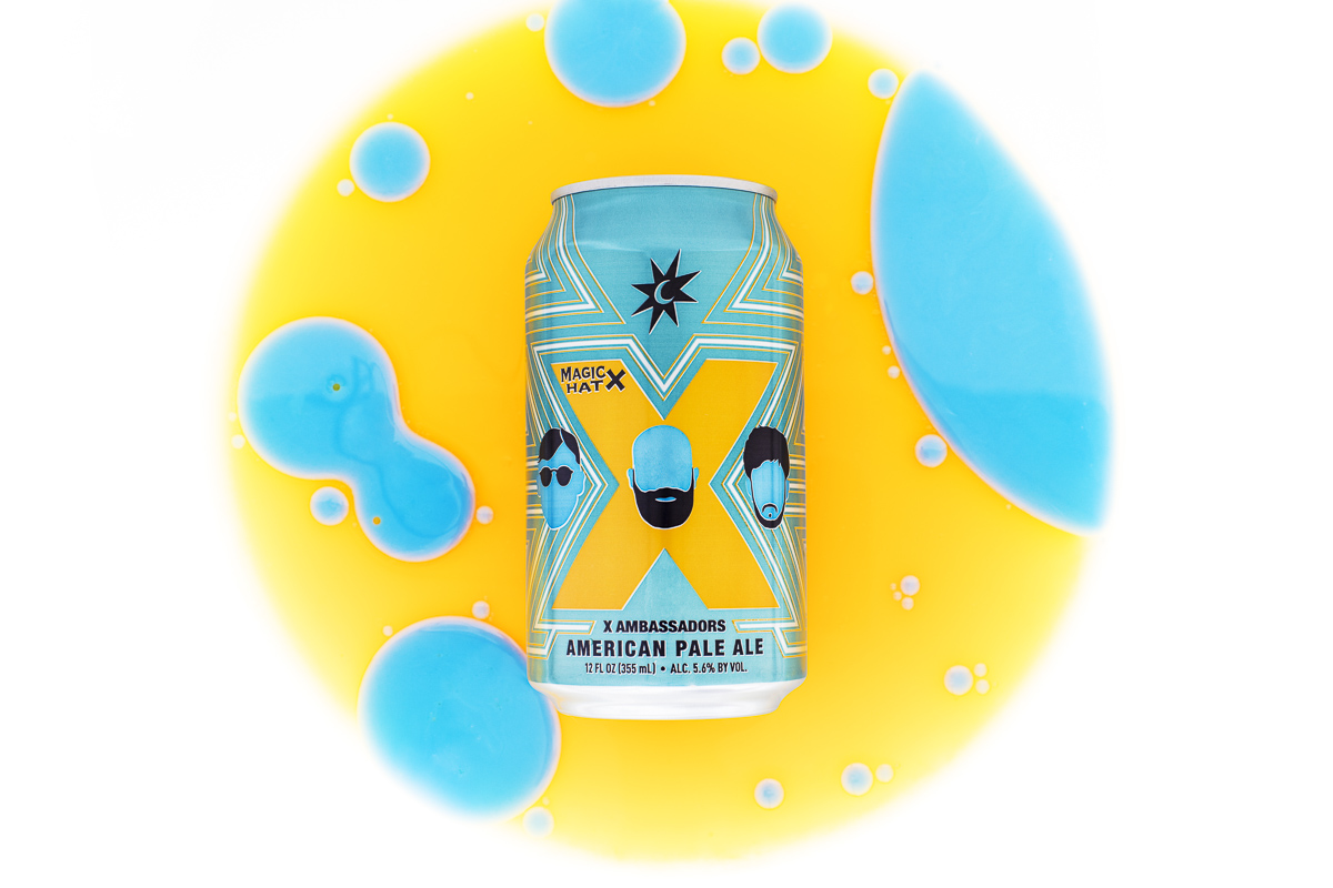 Magic Hat Brewing Company beer X Ambassadors American pale ale with yellow and blue circles on white background.