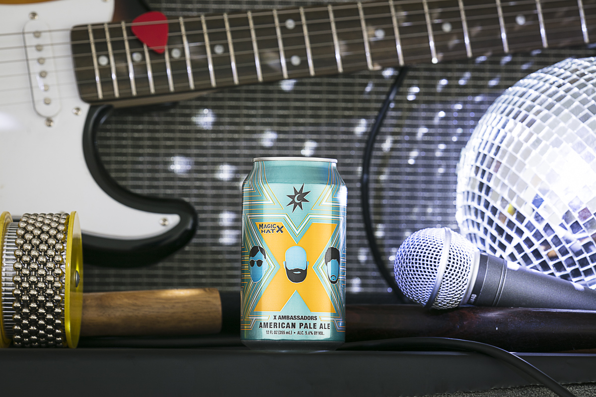Magic Hat Brewing Company beer X Ambassadors American pale ale with guitar, amp, microphone and disco ball.