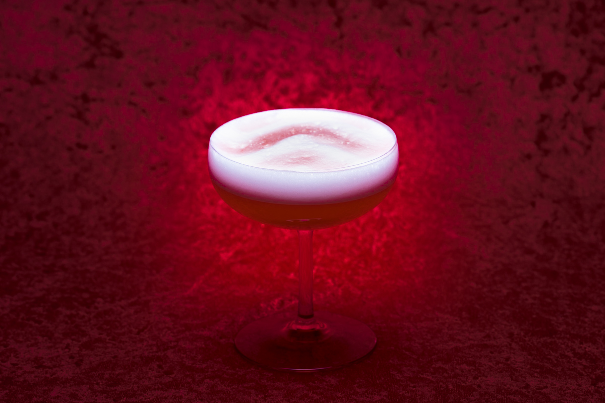 Stonecutter Spirits Twin Peaks themed cocktail on a red velvet background. By commercial photographers at JAM Creative.