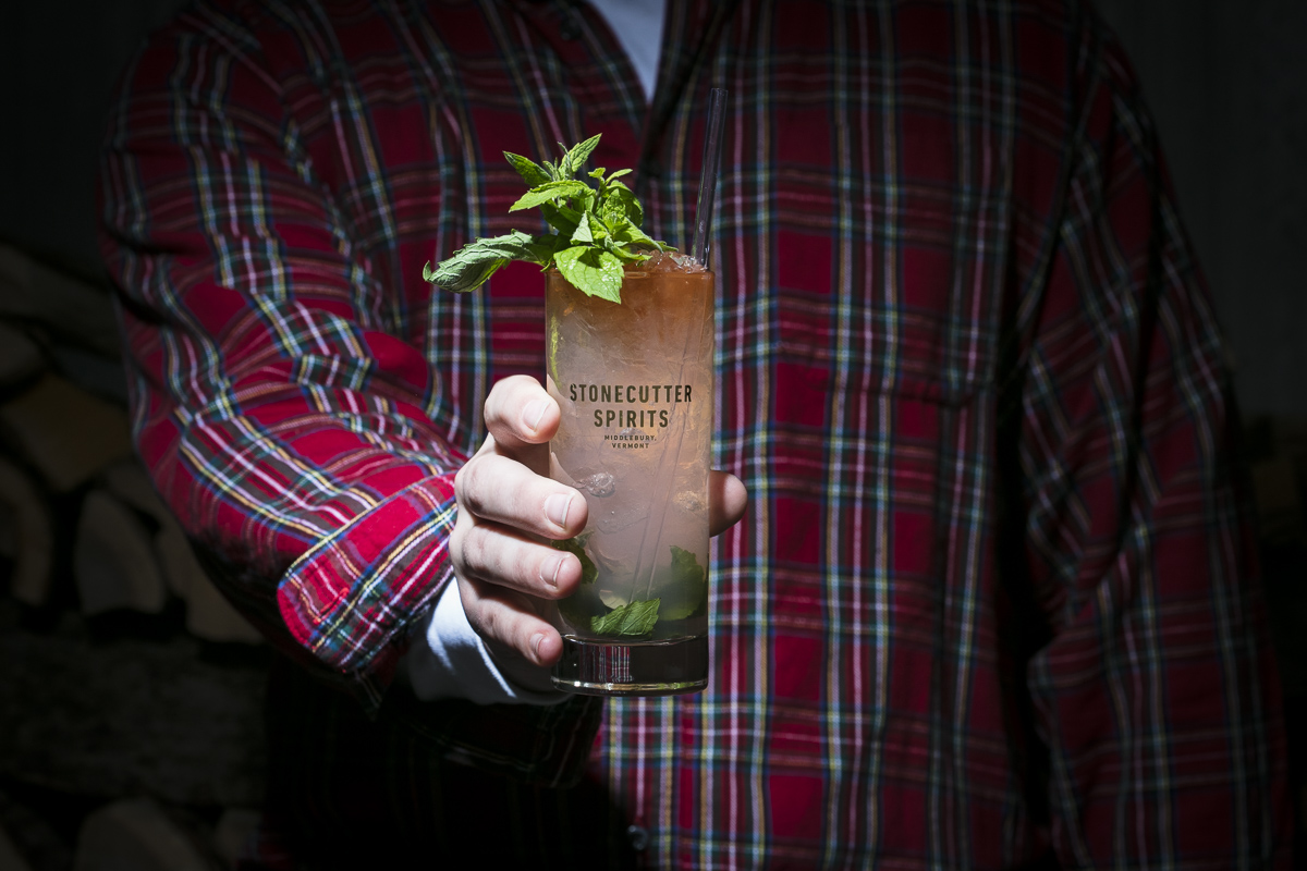 Stonecutter Spirits Twin Peaks themed cocktail with hands and flannel shirt. By commercial photographers at JAM Creative.