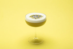 Stonecutter Spirits egg white cocktail on a yellow background. By commercial photographers at JAM Creative.