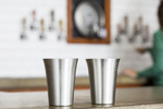 Pewter pint glasses being filled at Zero Gravity Brewery. Cups by Danforth Pewter photographed by JAM Creative