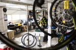 Bicycle tires in the Vermont Bicycling and Walking Vacations bike barn in Bristol, Vermont. by JAM Creative