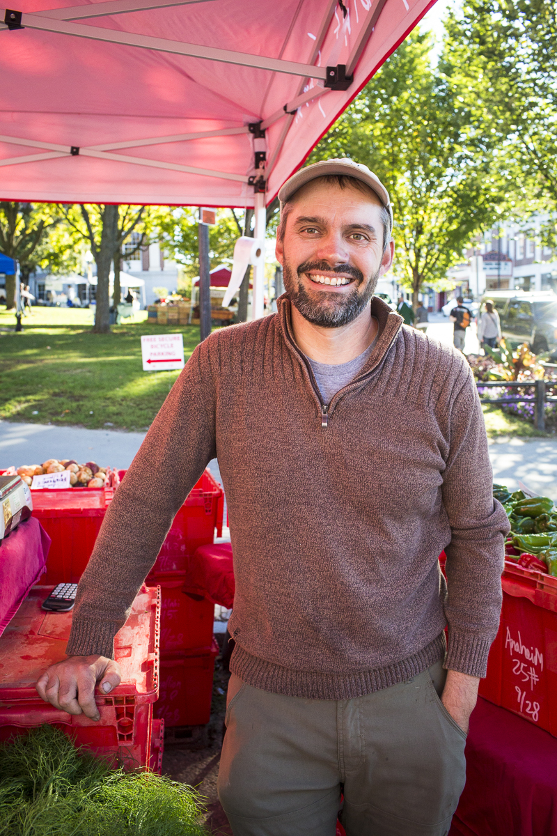 Spencer Welton of Half Pint Farm poses for a portrait at the Burlington Farmers Market in City Hall Park on Saturday, September 29, 2018. by JAM Creative for Yankee Magazine