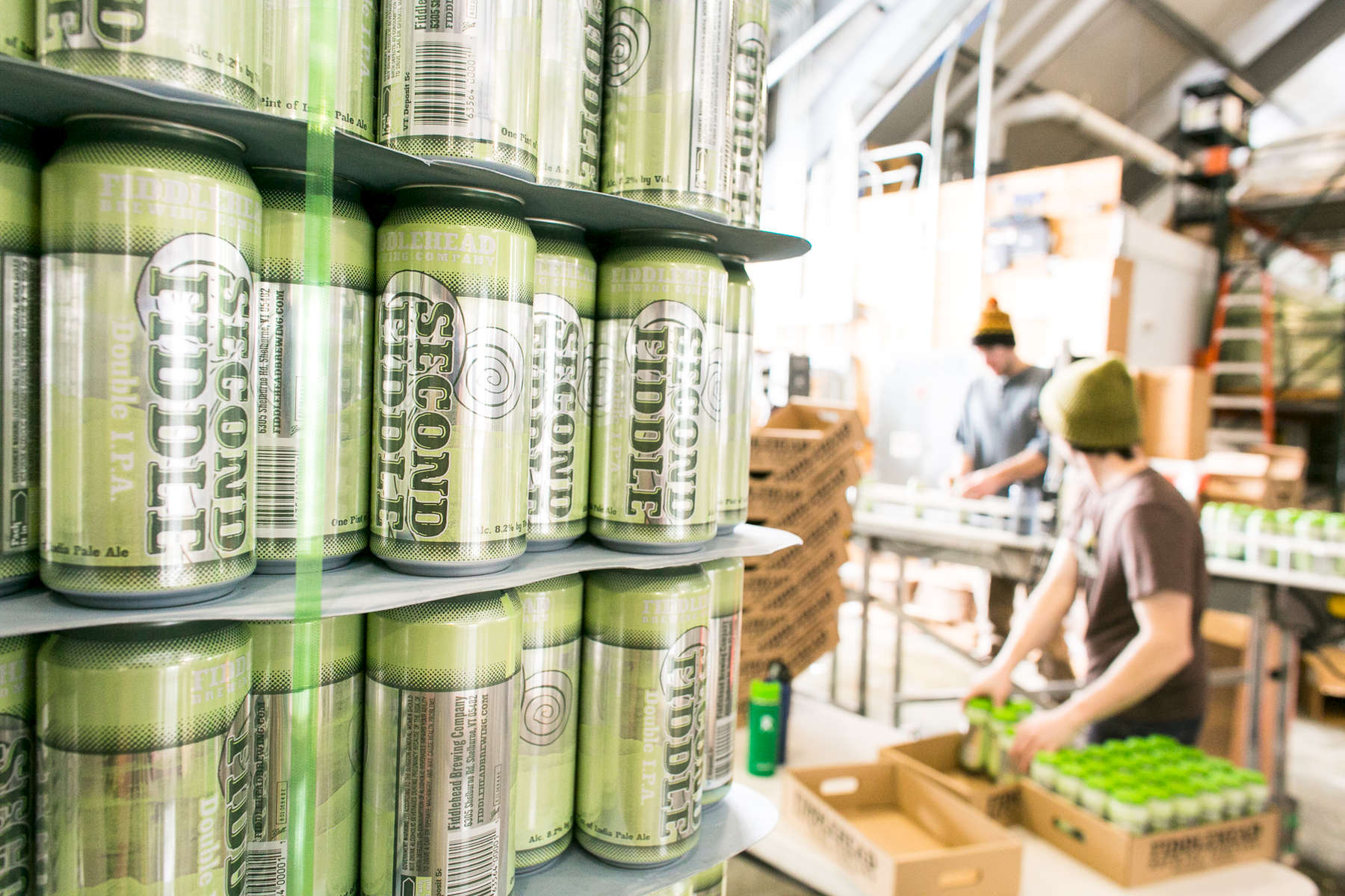 Behind the scenes shot of the brewery staff canning the famous Second Fiddle IPA.