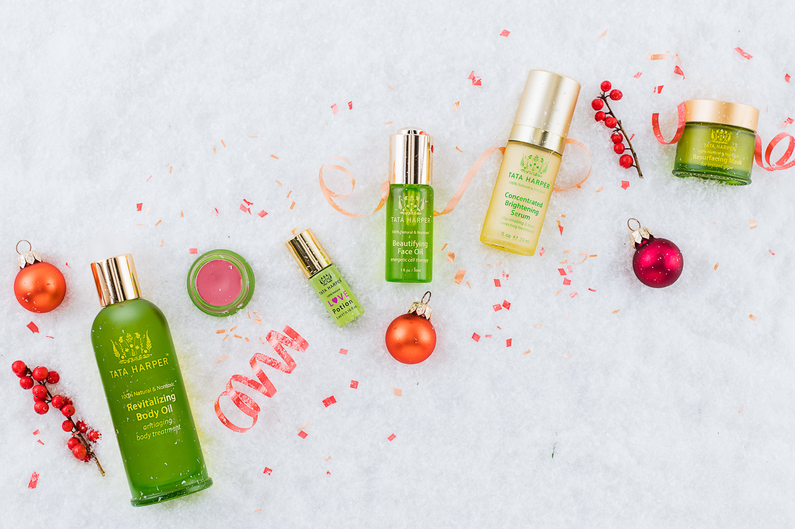 Tata Harper Revitalizing Body Oil, Love Potion, Beautifying Face Oil, Concentrated Brightening Serum and Revitalizing Mask with ornaments, confetti and snow. Shot at Reciprocity Studio in Burlington, Vermont for Tata Harper Skin Care.