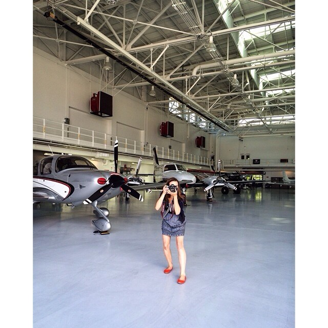 Vermont photographers Monica Donovan and Judd Lamphere of Reciprocity Studio: Monica shoots at Heritage Aviation during a scouting visit.
