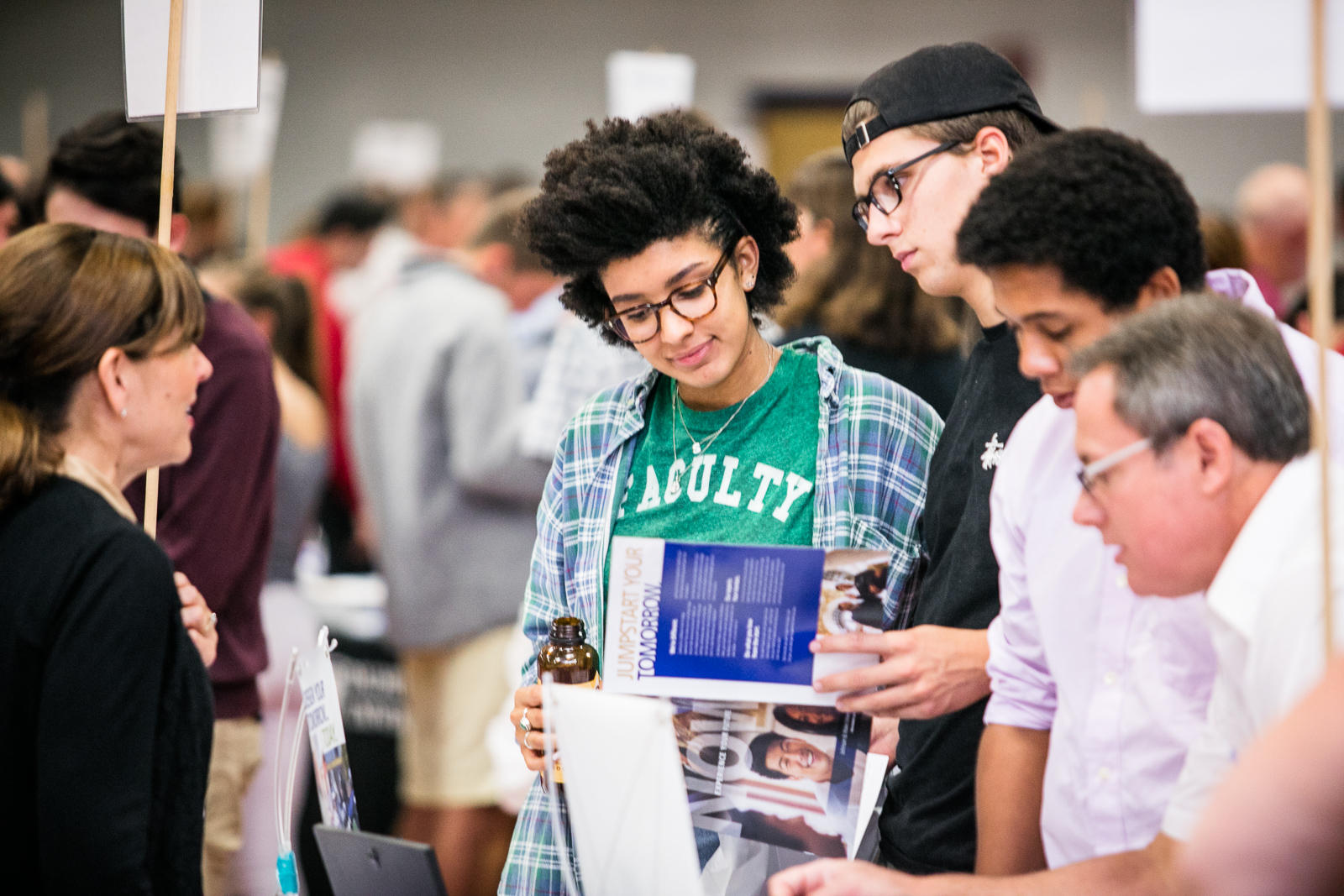 High school students explore college options at the annual VSAC College Fair at Saint Michael's College in Winooski, Vermont. by photographers at Reciprocity Studio for the Vermont Student Assistance Corporation (VSAC)
