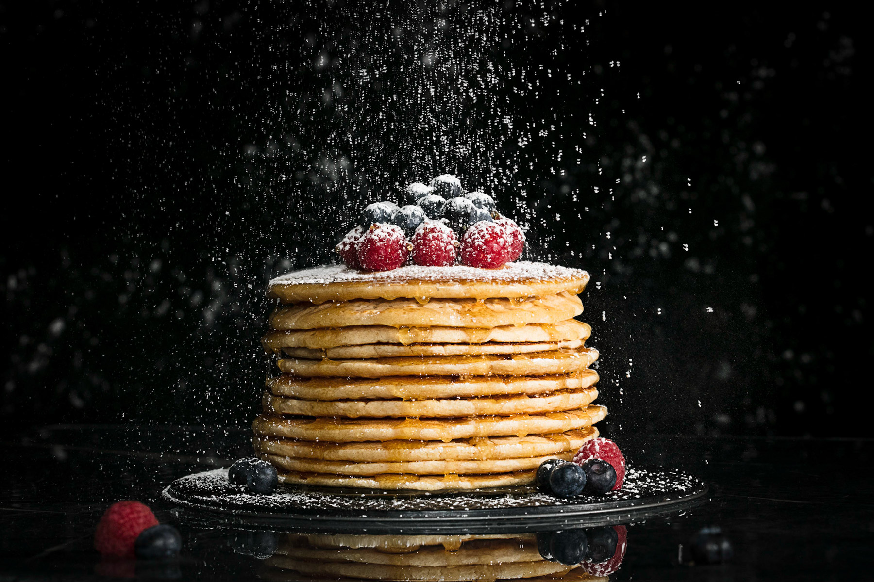 Food Photography of pancakes and maple syrup and berries for runamok maple. by Burlington Vermont Commercial Photographers JAM Creative.