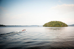 Island and boat on Upper Saranac Lake, Adirondack Park, New York. by Vermont photographers at Reciprocity Studio, Burlington