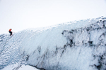 One man ice climbing on a glacier in Iceland. by Vermont photographers at Reciprocity Studio, Burlington