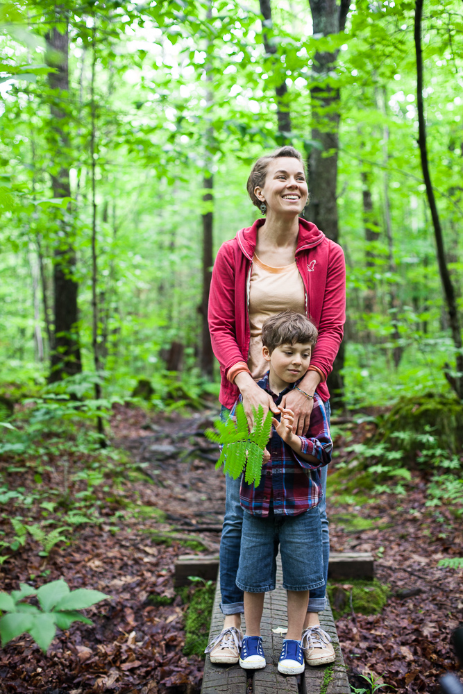 <p>Mother and son walking through woods. by Vermont photographers at Reciprocity Studio, Burlington</p>