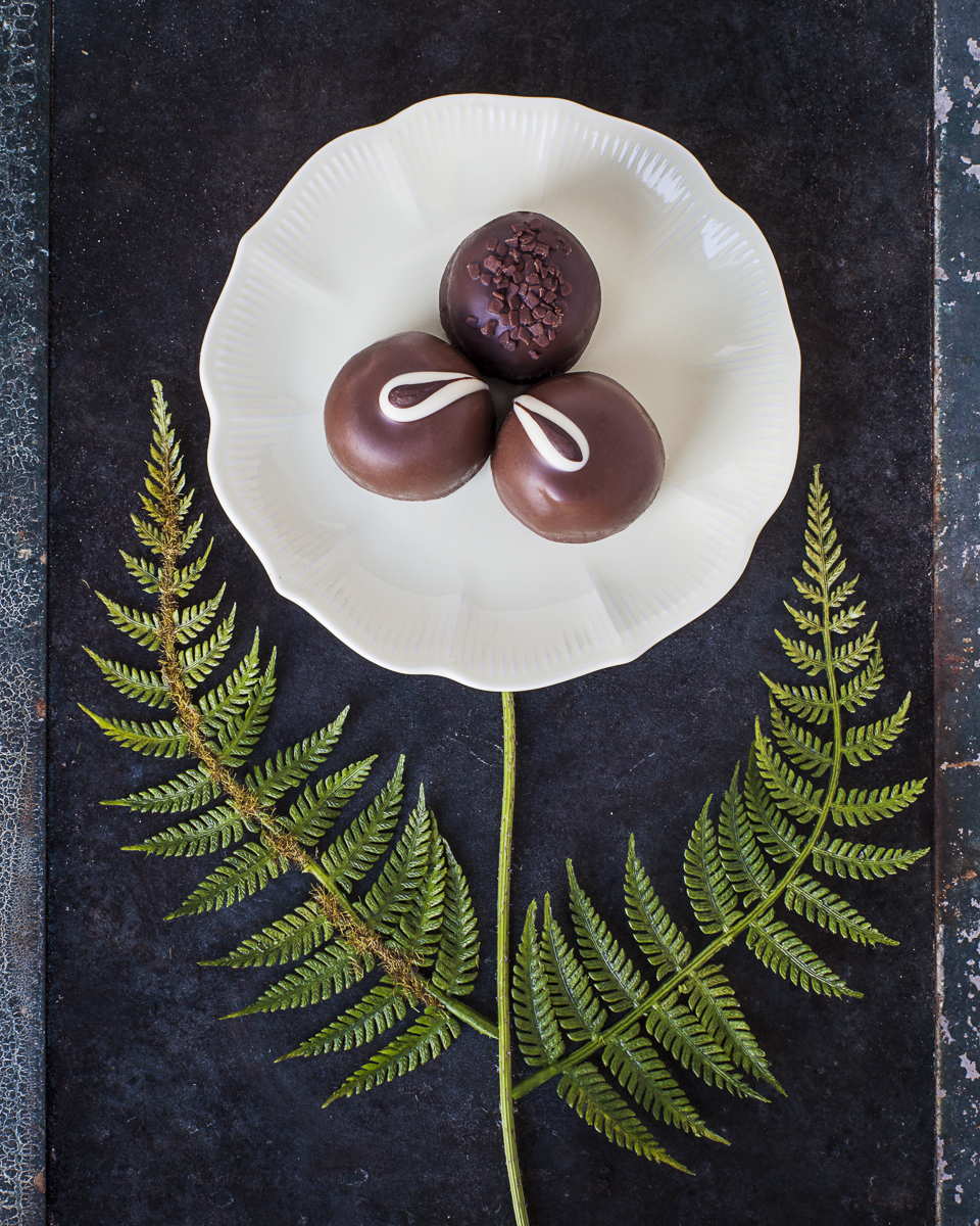 <p>Chocolate flower shape on a plate, by Vermont photographers Reciprocity Studio in Burlington.</p>