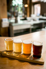 A tasty beer sampler sits atop a classic wooden bar at Von Trapp Brewery and Bierhall in Stowe Vermont.