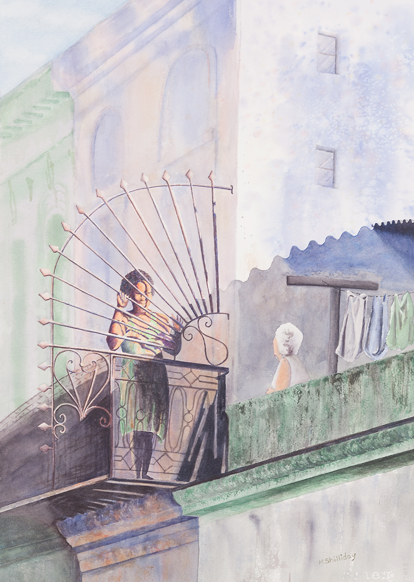 Two women talking on balcony in Havana, Cuba.
