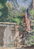 Old gated enterance of a Santa Barbara house with American Flag.