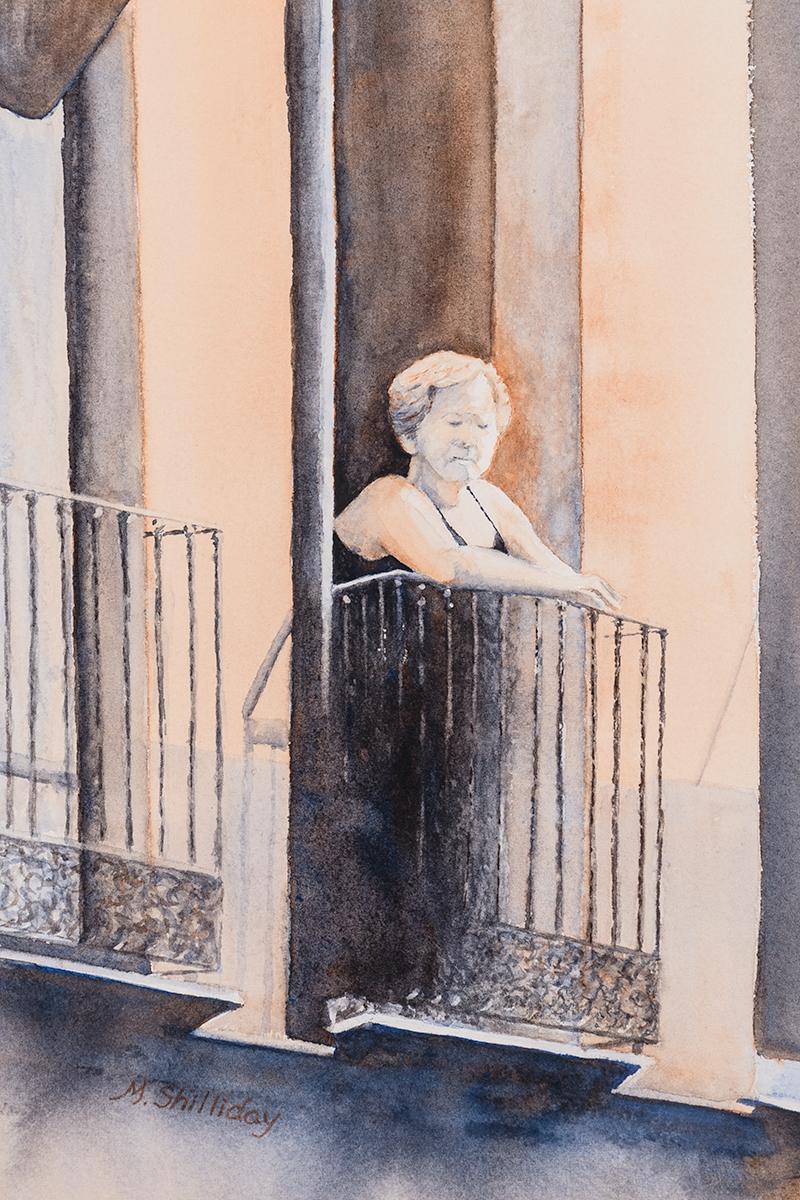 Lady on balcony, Malaga, Spain.