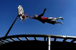 Myles McCadney, 15, glides through the air and jams the ball into the basket during a trampolinedunk contest with his friends in San Bernardino, Calif. (The Press-Enterprise/ Mark Zaleski)