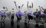 A group of women in tutus warm up in the rain before the 5K Color Run in Nashville, Tenn. (Mark Zaleski/ For The Tennessean)