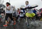 Runners splash through the rain at the start of the 5K Color Run in Nashville, Tenn. (Mark Zaleski/ For The Tennessean)