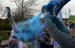 A runner gets squirted with blue powderin the 5K Color Run in Nashville, Tenn. (Mark Zaleski/ For The Tennessean)