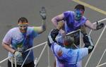 Participants celebrate near the finish line of the 5K Color Run in Nashville, Tenn.(Mark Zaleski/ For The Tennessean)