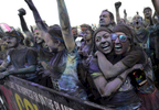 Runners listen to music in the festival areaafter the 5K Color Run in Nashville, Tenn.(Mark Zaleski/ For The Tennessean)