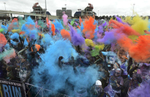 Runners celebrate in the parking lot of LP Field at the end of the Color Run in Nashville, Tenn. (Mark Zaleski/ For The Tennessean)