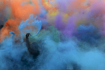 Runners spread colored powder in the air at the end of the Color Run in Nashville, Tenn.(Mark Zaleski/ For The Tennessean)