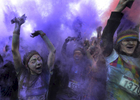 Runners celebrate as purple powder coats themat the end of the Color Run in Nashville, Tenn. (Mark Zaleski/ For The Tennessean)