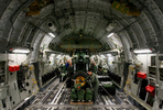 March Air Reserve Base C-17 aircrew Master Sgt. James ties down suppies in the cargo bay of the C-17 at McChord Air Force Base in Wash. (The Press-Enterprise/ Mark Zaleski)