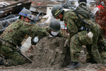 Thousands of people were unaccounted for a month after the tsunami hit Sendai, Japan. A team looks for the remains of those missing.(The Press-Enterprise/ Mark Zaleski)