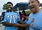 Tennessee Titians first-round draft pick Chance Warmack and David Davoudpour share a laugh together at the Shoney's 5K family fun run and walk benefiting the Nashville Police Support fund on June 1, 2013 in Nashville, Tenn.(The Tennessean/ Mark Zaleski)