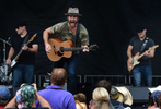 Drake White performs for the crowd at the Bud Light Stage at Bridgestone Arena during the 2013 Country Music Festival in Nashville, Tenn. (The Tennessean/ Mark Zaleski)