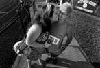 Jewel Trial surprises her great grandfather, Charles Trial, 78, with a kiss before he competed in the men's 400m and 1500m events during the Tennessee Senior Olympics State Finals in Franklin, Tenn. (Mark Zaleski/ The Tennessean)