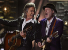 Jim Lauderdale, left, and Buddy Miller perform during the 2014 Americana Music Honors and Awards in Nashville, Tenn. (AP Photo/ Mark Zaleski)