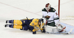 Nashville Predators forward Eric Nystrom collides with Minnesota Wild goalie Niklas Backstrom after being slashed resulting in a penalty shot in the first period of an NHL hockey game on Oct. 8, 2013, in Nashville, Tenn. (The Tennessean/ Mark Zaleski)