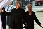 "Marty Stuart and Connie Smith arrive at the ceremony for the 2013 inductions into the Country Music Hall of Fame in Nashville, Tenn. The inductees are Bobby Bare, the late ""Cowboy"" Jack Clement and Kenny Rogers. (AP Photo/ Mark Zaleski)"